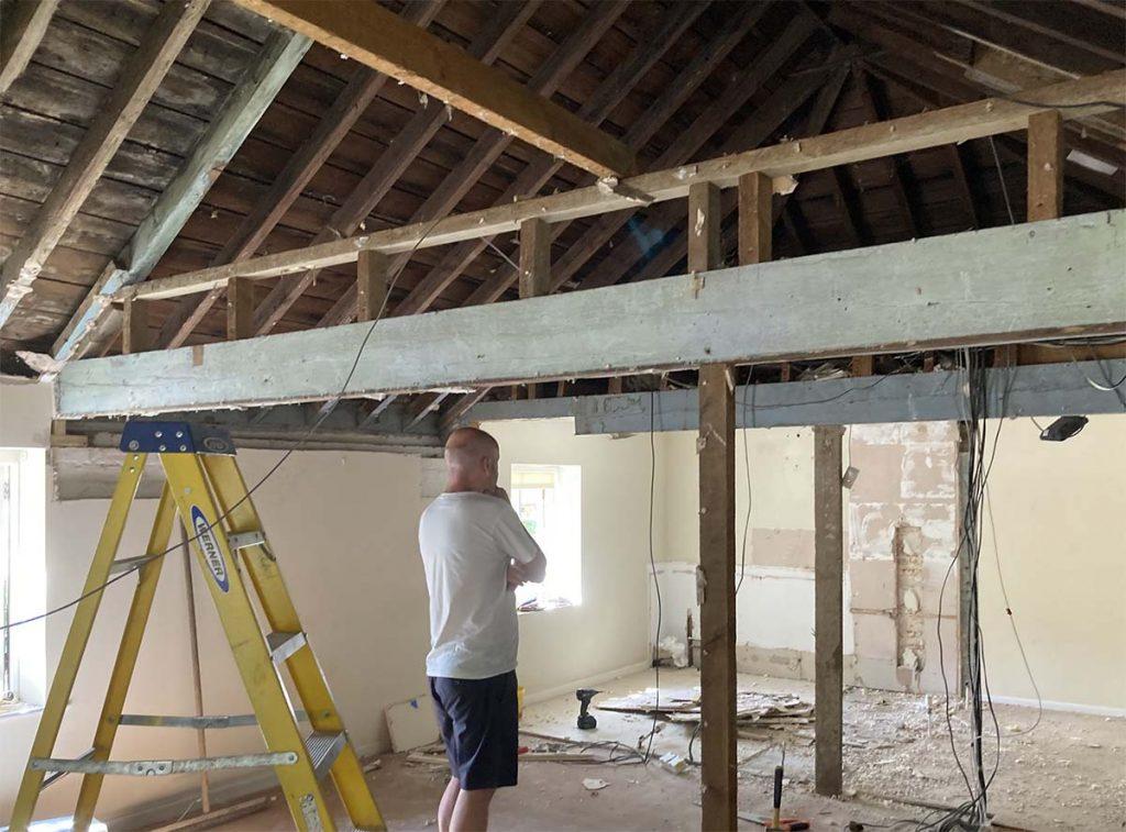 demolition designer thinking on site